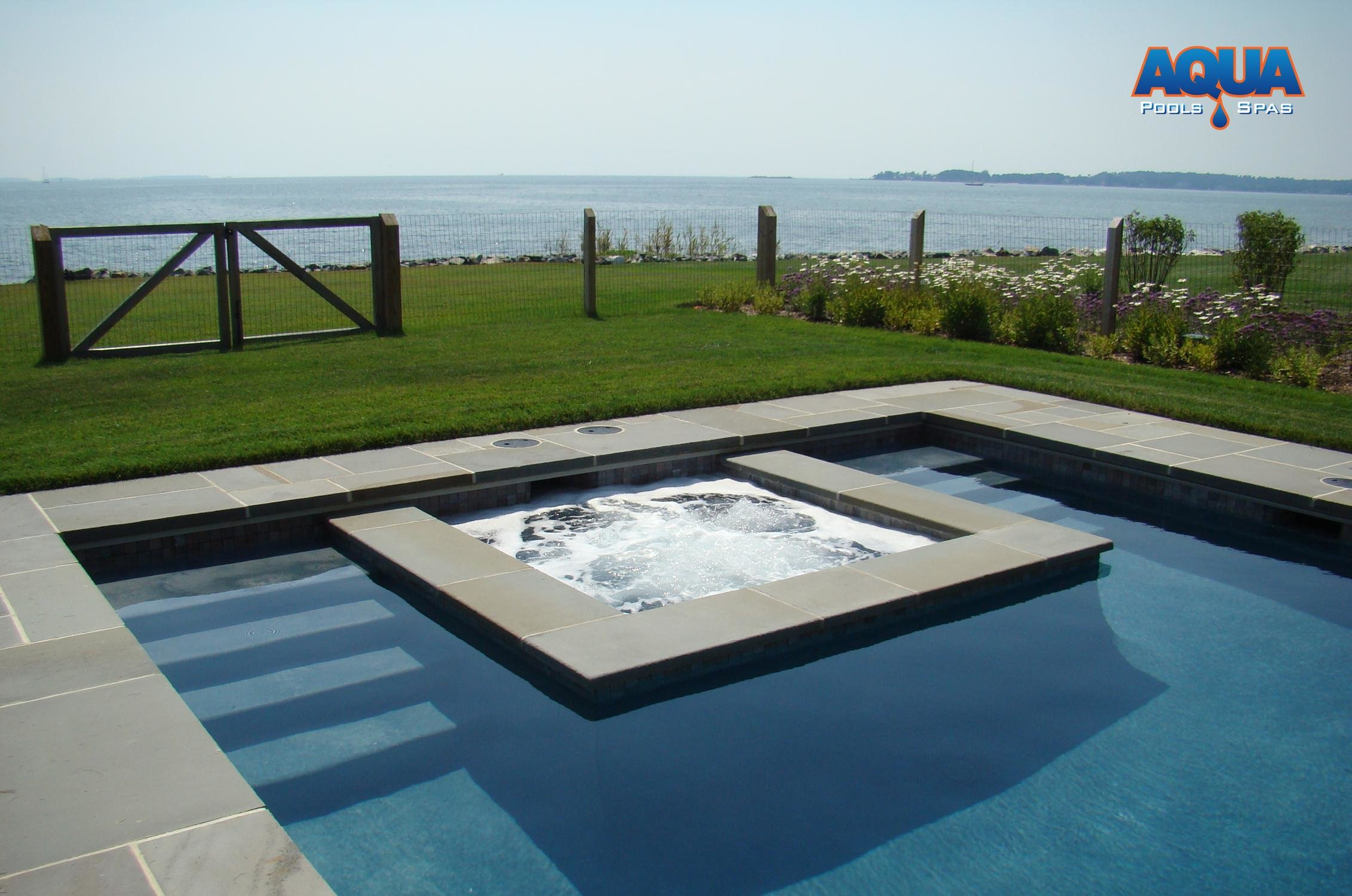 even here within the pool the bodies of water are separate - Rectangle Pool With Spa