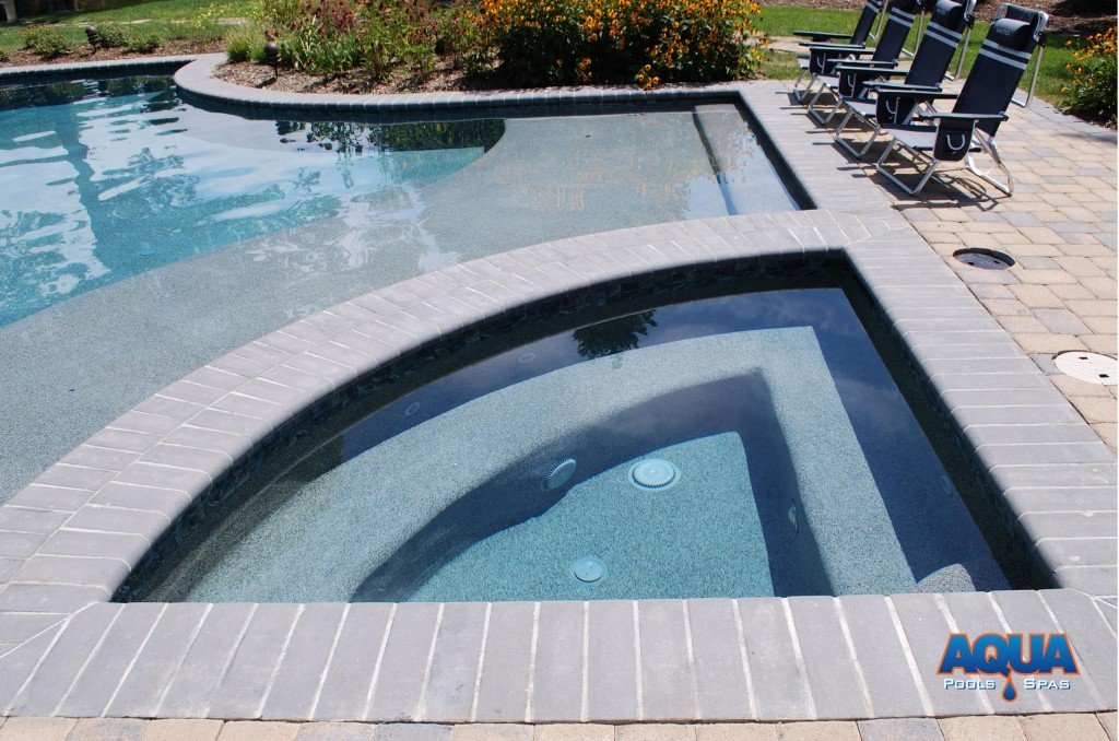 This custom hot tub in the Bennett Point area of Queenstown Maryland features a complimentary triangular shape.